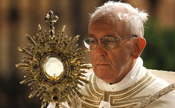 Pope Francis carries a monstrance holding the Blessed Sacrament during the Corpus Christi observance May 30 in Rome. (CNS photo/Paul Haring)  (May 30, 2013) See POPE-CORPUSCHRISTI May 30, 2013.