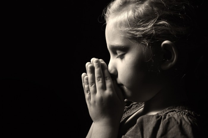 Praying child.